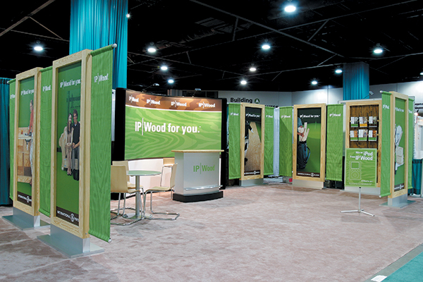 Modular display system comprised of 7-foot free-standing graphics panels constructed from actual IP Wood lumber and plywood products.